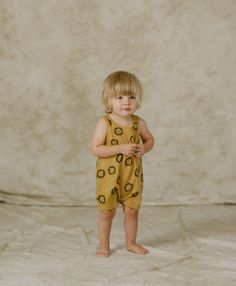 A whole pride of happy lion faces on a shorty sleeveless romper. Snaps at inseam for easy dressing and diapering. See also Bow Tie Romper, Lions Jumpsuit and Lions Basic Tee. - Materials: 100% Cotton