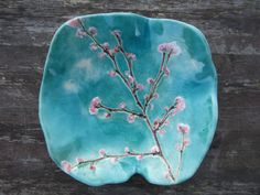 handmade ceramic bowl with beautiful delicate cherry blossom painted in turquoise dreamy white clouded sky