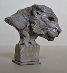 A sculpture titled 'Tiger Head (Small/Little Mask/Face/Trophy statuette/ornament/figurine)(bronze)' by artist Edward Waites in the category Cats Wild and Big Cats Sculpture. This sculpture has the dimensions of 10 x 10 x 8 cm, the sculpture is sculpted from a medium of 'bronze'. Small or Little Bronze Tiger`s Head /Mask/Bust/Face for sale. By the English sculptor Edward Waites for Indoors on the Tabletop or Desk Top or Inside the House on the Shelf or in the Cabinet.