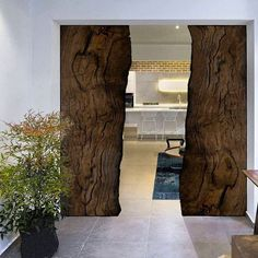 Made from over 1000 year old Bog Oak, this sliding door was designed by Davide Del Gallo.  This natural process starts in rivers. Cut down or fallen tree trunks immersed deep into cold water without oxygen or light slowly acquire unique strength & aesthetic values. The combination of water, minerals time, & biophysical conditions creates a unique drawing and color. This would look great in our Rising Barns.  Risingbarn.com