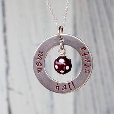 Mississippi State University Hail State inspired Hand by AprilCLee, $39.00---I loathe football with the heat of a thousand suns but I do like this necklace and MSU. ;)