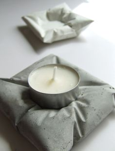 Concrete candle holders, very cool for outdoors