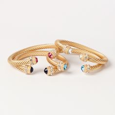 A perfectly twisted addition to your bracelet bar, these twisted cable cuff bracelets are refined elegance defined. Each twisted metal cuff bracelet has glittering cz stones set into the heads surrounded by pretty clear stones.