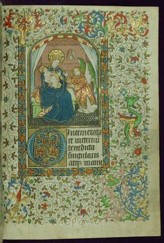 Book of Hours Virgin and Child with angel presenting a white flower Walters Manuscript W.267 fol. 184r by Walters Art Museum Illuminated Manuscripts