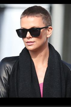 The woman is so pretty she can pull off a freakin shaved head!