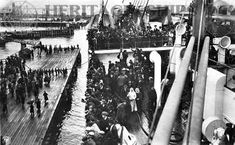 Hamburg America Line steamship built 1913 at Hamburg by Blohm Voss. On this image we can se a large crowd on steerage passengers on the deck of the ship as she ship approaches the pier.