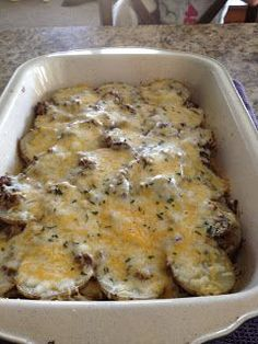 Texas Potatoes - 1 lbs. Ground beef 2 to 4 potatoes (depending on how thin you want to slice it) uncooked 3/4 cup diced onion (you can always use more) 1 clove garlic pressed or diced One package of the baby bella mushrooms sliced Dried parsley or fresh, about a Tbls. 1 tsp. of garlic salt 1 tsp. of onion powder A few pinches of pepper 1 can of cream of mushroom soup 1 cup or so of cheddar and jack cheese (you can change to a cheese that you may prefer more)
