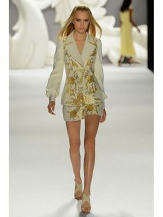Carolina Herrera cream and gold jacquard skirt suit shown during Mercedes Benz Fashion Week Spring/Summer 2013 in New York City. #NYFW #models
