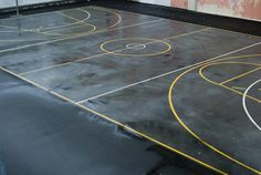 Love this image: Overhead view of a deserted wet basketball court with clear markings - By stockarch.com user: stockarch