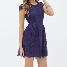 Lace Eyelash Dress Adorable lace eyelash dress with cap sleeves in a deep navy blue color. Good condition, no major flaws. Forever 21 Dresses