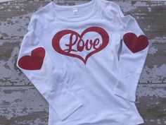 The Love Applique and Heart decals are made of glitter vinyl! Looking for a different color? Just ask! Onesie sizes: Newborn 6 month 12 month 18 month 24 month T-Shirt Sizes 6 month 12 month 18 month