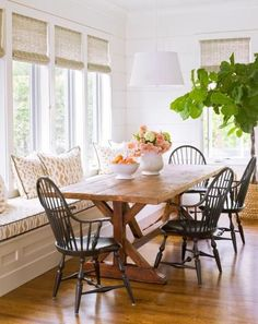 Kitchen banquette: If you host lots of guests, consider one long window seat. More ideas for kitchen banquettes: http://www.midwestliving.com/homes/decorating-ideas/6-ideas-for-kitchen-banquettes/?page=4
