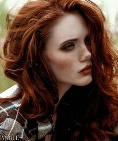 Beautiful multidimensional Red Head with Long Layers , Blown dry with Round brush and Clipless Iron used for soft curl.