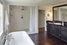 """Master Bath 12'8""""x12"""" Oversized 'open' shower with curtain in place of predictable glass enclosure.  Renee Zellweger's Federal Colonial-Style Farmhouse"""