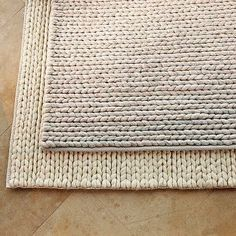 Chunky braid rug - I like the braided rugs in rectangular shapes. I wonder if it would work to knit one strip instead of braid three together?