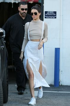 Kendall Jenner wearing  Acne Studios Aline rib light beige, Nike Thea Running Sneakers , Saint Laurent Classic 11 Aviator Sunglasses