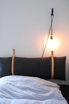 Fin DIY sengegavl lavet af en aflang pude og to læderremme