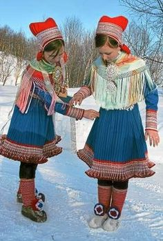 Europe | Portrait of two Saami girls wearing traditional clothes, Lapland, Norway #plisse #embroidery #fringe
