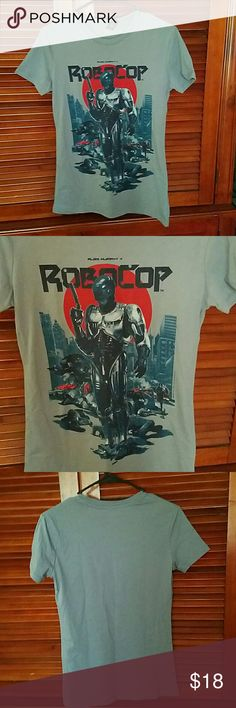 NWOT Robocop tee NWOT Got it in my lootcrate but not a big fan of Robocop.    Gray with red and blue printed pattern. Listed as HT to reach the right crowd. Open to offers! Hot Topic Tops Tees - Short Sleeve