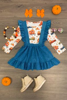 Your girl will fall in love with the simple and sleek style of this suede suspender skirt set. A long sleeve pumpkin truck print top paired with a blue suede suspender skirt with ruffle suspenders to complete the look. Kids Outfits Girls, Toddler Outfits, Boy Outfits, Cute Outfits, Baby Girl Fashion, Kids Fashion, Toddler Girl Style, Suspender Skirt, Baby Kids Clothes