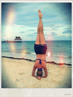 Another Mexican beach headstand.  Beautiful over-the-water-hut off in the distance.