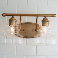Modern Ridged Shade Vanity Light - 2 Light Modern Ridged Shade Bath Light - 2 Light aged_brass<br> Unique ridged glass shades are the perfect complement to the sleek, clean metal lines utilized by this beautiful modern bath sconce. Brass Bathroom Fixtures, Bathroom Chandelier, Bathroom Wall Sconces, Bathroom Vanity Lighting, Master Bathroom, Copper Lighting, Outdoor Wall Lighting, Bar Lighting, Chandelier Lighting