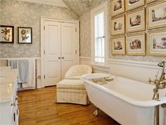 Great bathtub. Do you like the way the pictures are hung in this room?