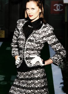 black and white Chanel tweed suit