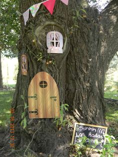Fairy Party---You could make doors and windows out of cardboard and paint to look more realistic. Attach to trees and I am sure it will bring smile to the faces of your guest....Image Only Pirate Fairy Party, Fairy Birthday Party, Fairy Party Ideas, Garden Birthday, 4th Birthday Parties, 5th Birthday, Birthday Ideas, Happy Birthday, Enchanted Forest Party