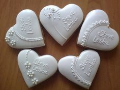 White on white heart cookies with delicate piping - perfect for Valentine's Day, wedding, or birthday.