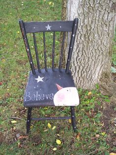 Handpainted Snowman Chair. $50.00, via Etsy. Or I could make one.