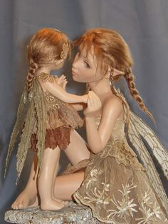 """I lov e this art..the details..work...hours..put into this form or art..the """"doll""""..ooak...from the clothing to the hair..to the smallest detail..is amazing.. """"fairy mother and child""""..a favorite of mine"""
