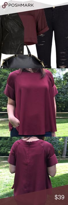 "Top Shop Burgundy Satin Sleeves Top NWOT Burgundy color top with small back zipper from Top Shop. Made of polyester. Measures from pit to pit 23""/ length 21.5"". Tags say UK size 16 which is a US 12. Reasonable offers considered through offer button only. NO TRADES. Topshop Tops"