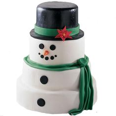 He's Snow Much Fun Cake - Four stacked cakes make this snowman a real crowd-pleaser!  He's covered with snow-white fondant and dressed for cold  weather with a fondant hat and scarf.