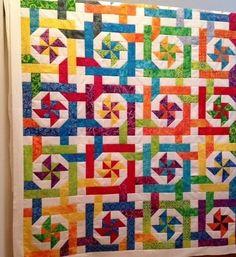 Pinwheel pParadise by Laura Coons Interlocking batik pinwheels