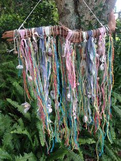 Imagine this with art yarns!    I handcrafted a sea witch curtain, made from crystals, hag stones, shells and lots of magic! To keep negativity out of the home!