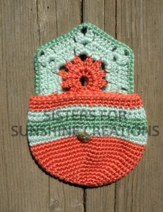 Coral, light blue, and sage green crochet bag, handmade by Sisters for Sunshine Creations