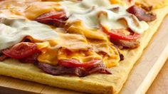 Make a  fresh and fab new pizza -- bacon, fresh tomatoes and two cheeses on a flaky Crescent crust -- in less time than it takes to order take-out.