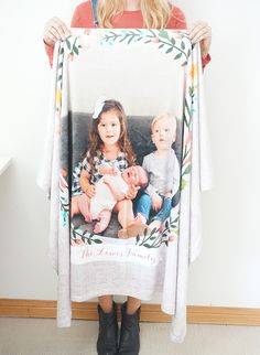What's even more personal than a monogrammed blanket? A photo blanket! There are plenty of blankets with multiple photo options, but we love how this floral wreath makes the family photo stand out.