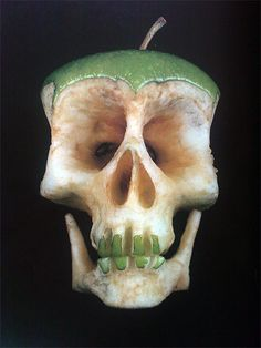 Scary skull made with an apple  via http://are2.tumblr.com/post/12163557763/edible-halloween