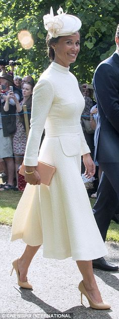 Spot the difference: Pippa Middleton, 31, wore a cream Emilia Wickstead dress, which match...