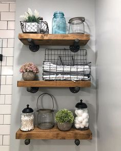 Warming up this gray, black and white bathroom with these great rustic wood shelves, some vintage wire baskets and pops of greenery & color. ⠀ 36 Beautiful Farmhouse Bathroom Design and Decor Ideas You Will Go Crazy For Rustic Wood Shelving, Industrial Shelves, White Wood Shelves, Diy Wood Shelves, Reclaimed Wood Shelves, Vintage Shelving, Decorative Shelves, Decorative Items, Vintage Wire Baskets