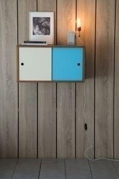 Bala teak small storage: http://www.kanndesign.com/en/product/bala-fifties-storage-teak-white-blue