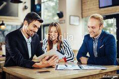 """Laden Sie das lizenzfreie Foto """"Small group of young people at a business meeting in a cafe"""" von djile zum günstigen Preis auf Fotolia.com herunter. Stöbern Sie in unserer Bilddatenbank und finden Sie schnell das perfekte Stockfoto für Ihr Marketing-Projekt!"""