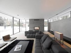 Modernes Wohnzimmer Mit Kamin Graues Sofaset Schwarzes Teppich