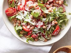 Unsalted canned black-eyed peas give the salad heft and texture, a great pairing for the light, crispy cakes. Bulk up any leftovers with ...