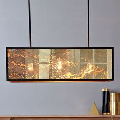 Panorama Chandelier from West Elm.  The retro-inspired Panorama Chandelier's mercury glass side panels give feasts a festive glow. Its vintage vibe is the ideal complement to a long dining table.