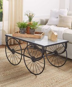 Accent your home in farmhouse style with this Galvanized Wagon Wheel Coffee Table. The generously sized tabletop is made of galvanized metal and rests on a soli Affordable Home Decor, Cheap Home Decor, Country Farmhouse Decor, Farmhouse Style, Modern Country, French Country, Modern Farmhouse, Rustic Coffee Tables, Rustic Table
