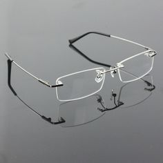 Cheap prescription glasses, Buy Quality glasses frame directly from China optical glasses frame Suppliers: Rimless Titanium Alloy flexible optical glasses frames spectacle frame degree point eyeglasses oculos de grau prescript glasses Rimless Glasses, Rimless Frames, Optical Glasses, Optical Frames, Mens Glasses, Glasses Frames, Prescription Lenses, Eyeglasses, Eyewear