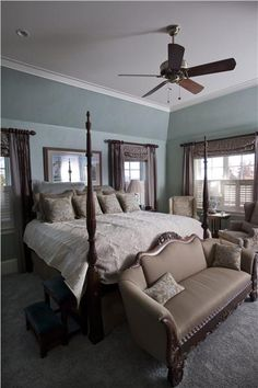 Cozy Traditional Bedroom by Amy  Conner-Murphy; love the couch at the foot of the bed!